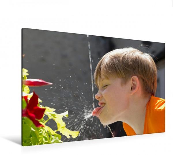 Wandbild Trinken an einem Brunnen Ein Junge trinkt Wasser an einem Brunnen. Ein Junge trinkt Wasser an einem Brunnen.