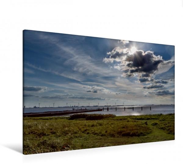 Wandbild Wolken über dem Dollart in Ostfriesland Eine Regenwolke gibt die Sonne wieder frei und spiegelt sich im Dollart Eine Regenwolke gibt die Sonne wieder frei und spiegelt sich im Dollart